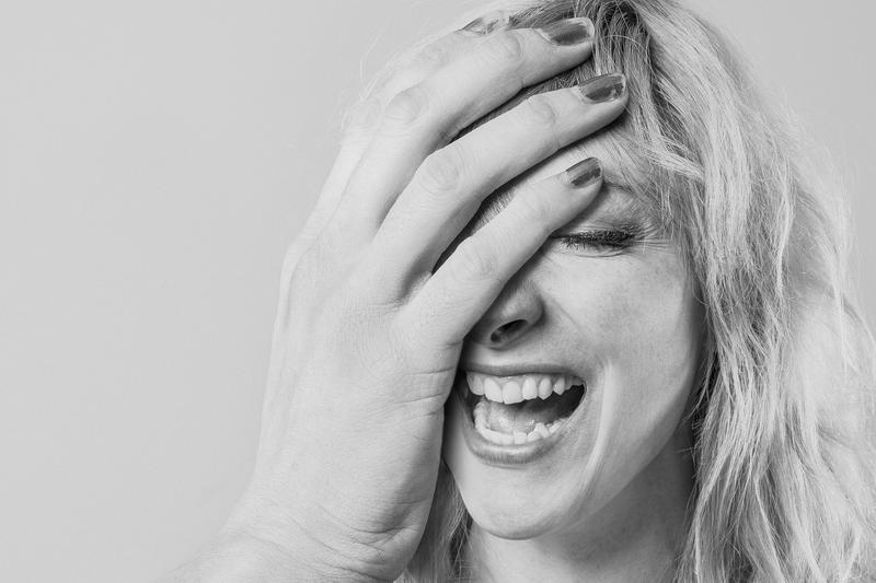 Woman With Absurdly Large Hand Laughing