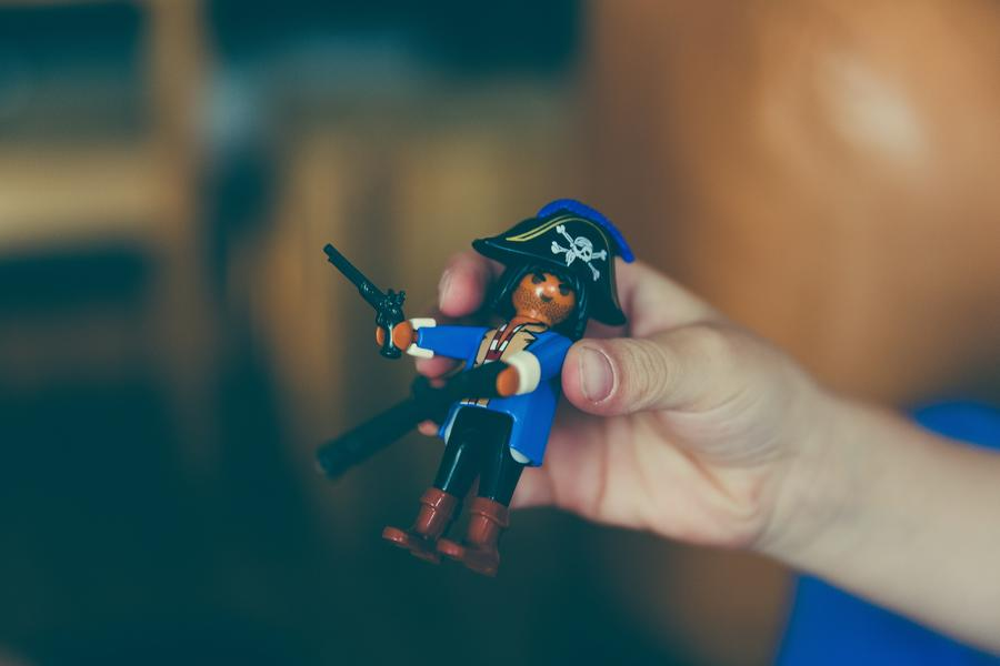 Pirate Toy In The Hands Of A Boy