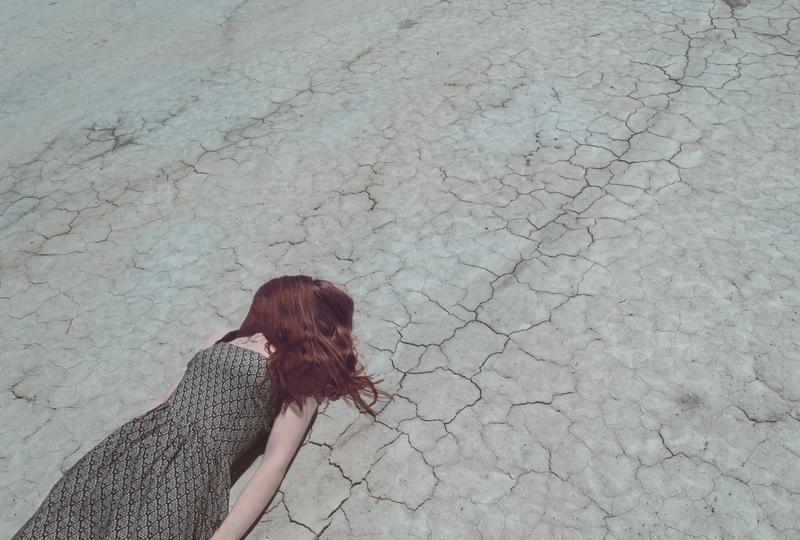 Girl Lost In Desert, laying down