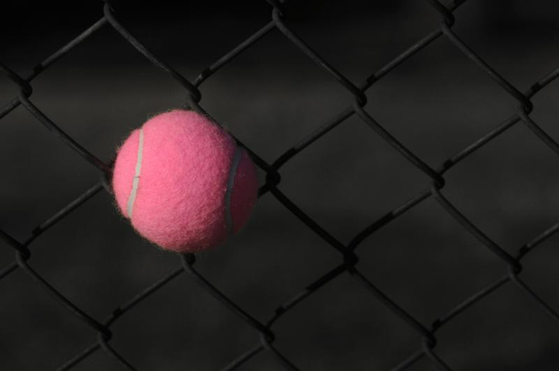 Pink Tennis Ball Stuck In The Fence