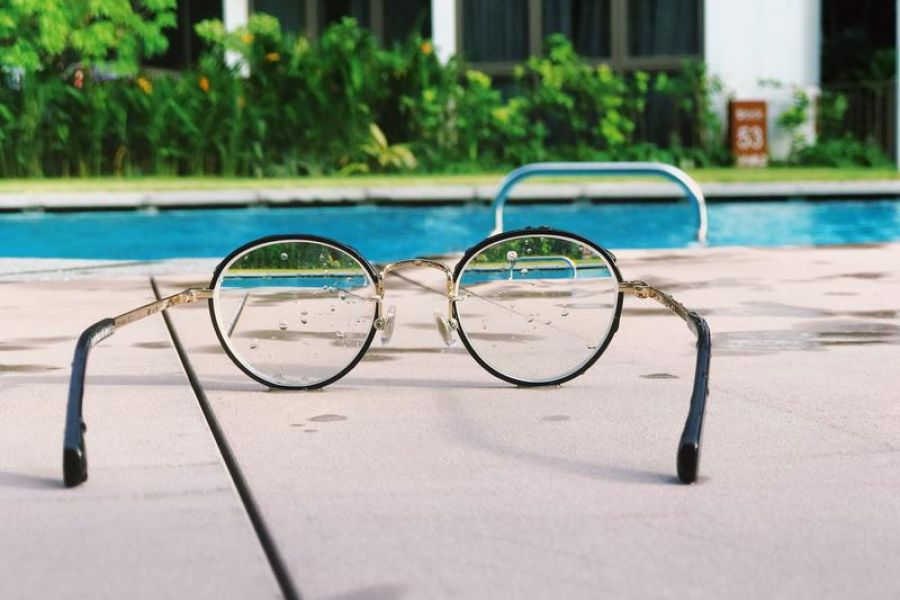 Photo of Glasses and swimming pool